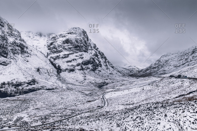 Dramatic winter snow mountain landscape in Glencoe Scotland