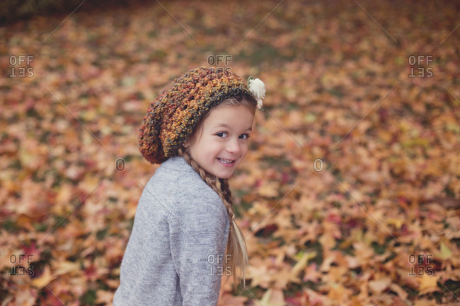 Little girl with sweet face in fall color setting