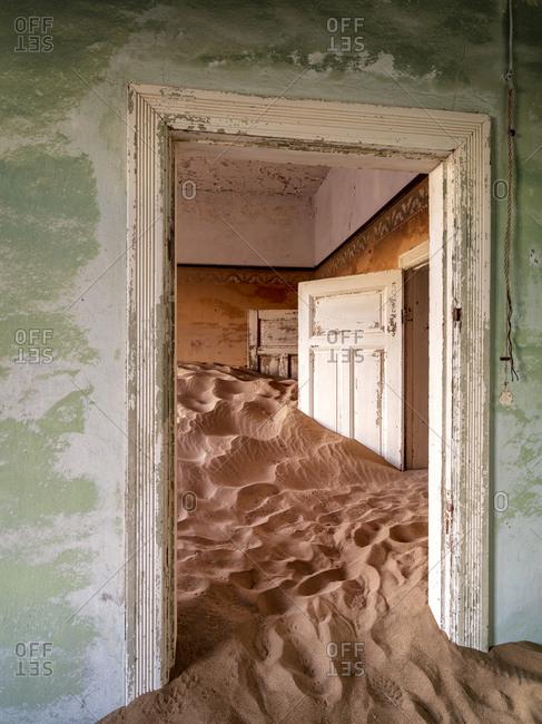Sand filling derelict architecture in Kolmanskop ghost town