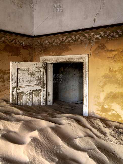 Sand filled abandoned building in Kolmanskop ghost town