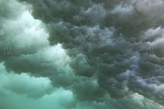Underwater view of cloudy waves