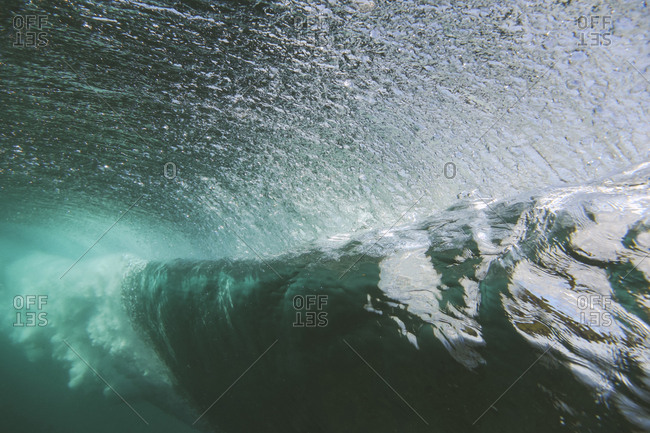 Underwater view of curling waves