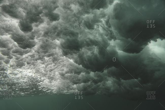 Underwater view of crashing waves in the ocean