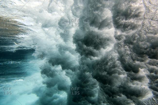 Powerful waves crashing in the ocean underwater