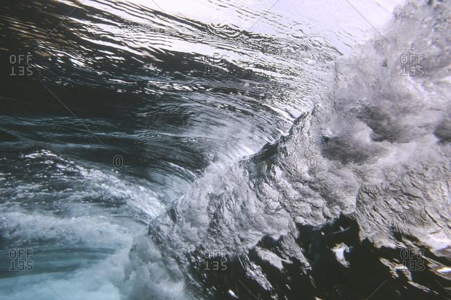 View of cresting waves in the ocean underwater