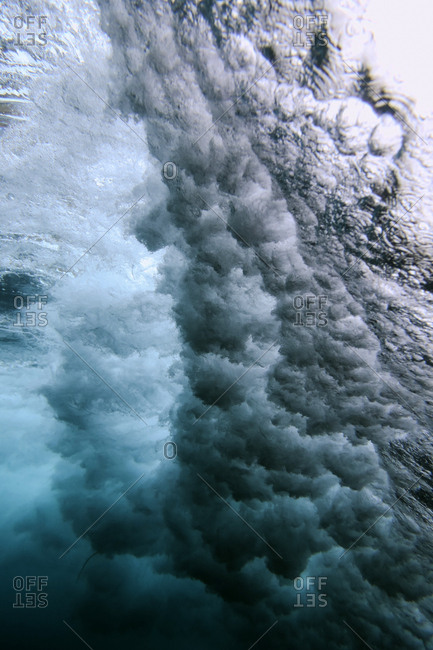 Underwater view of powerful splashing waves in the ocean