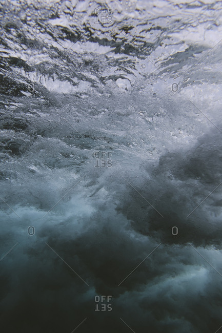 Underwater view of splashing waves in the ocean