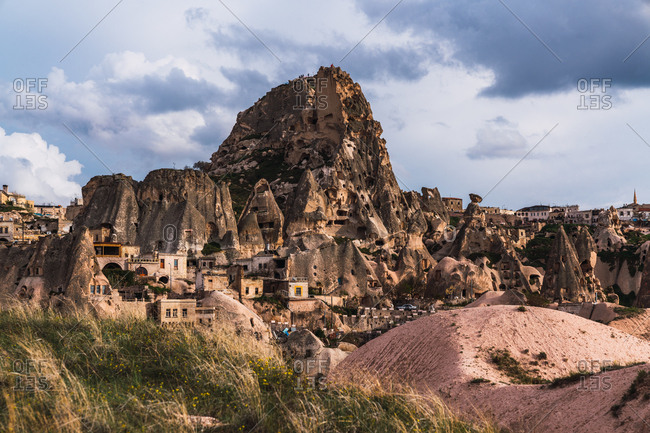 May 30, 2019: Picturesque view of ancient mountain fortress on background of cloudy sky in Cappadocia, Turkey