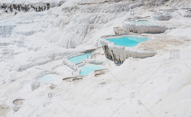 Beautiful natural travertine pools and terrace of carbonate minerals at Pamukkale, Turkey