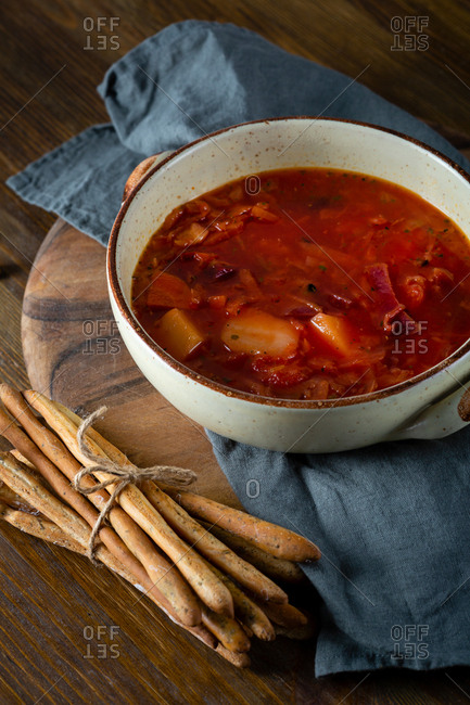 Vegan red soup and bread sticks