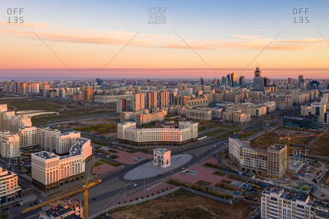 September 30, 2018: Aerial view of the Arch of Triumph, Nur Sultan, Kazakhstan at Sunrise. showing the construction of more matching tower blocks around the Arch of Triumph.