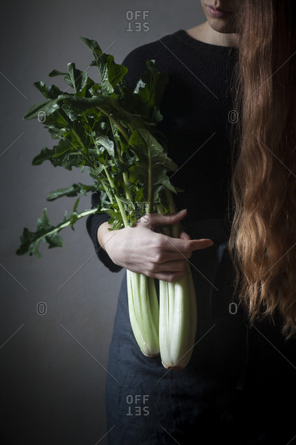 Girl with long hair holding chicory