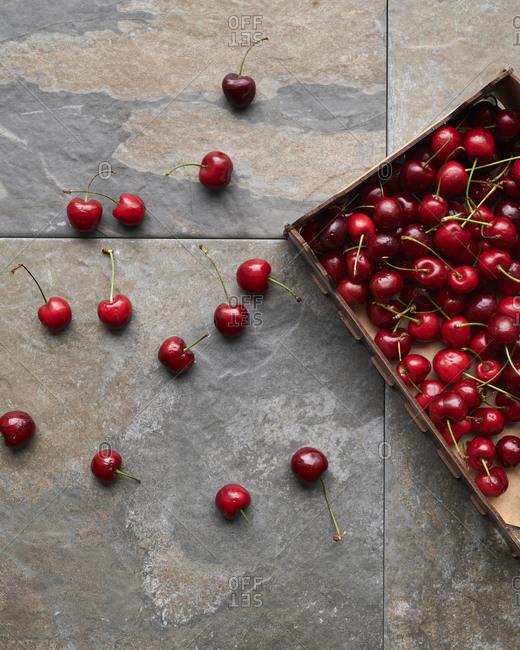 Cherries on stone background