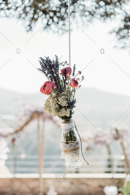 Bunch of flowers in glass hanging down