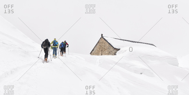 Georgia- Caucasus- Gudauri- people on a ski tour to Lomisi Monastery