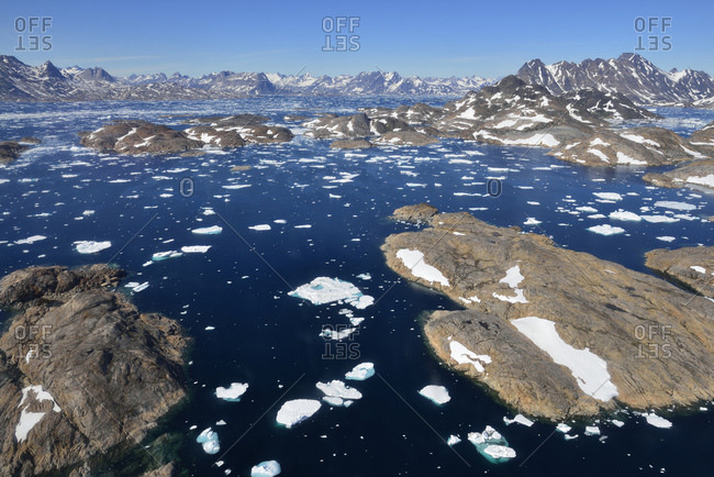 Greenland- East Greenland- Aerial view of Ammassalik island and fjord with pack or drift ice