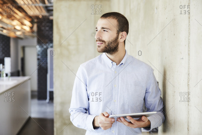 Businessman using tablet in modern office