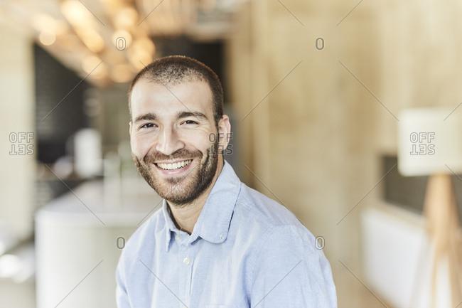 Portrait of happy businessman in modern office