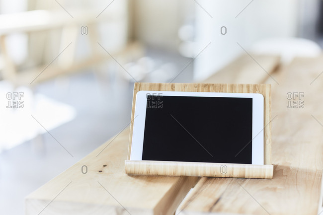 Tablet on wooden bench