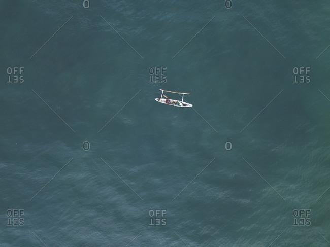 Indonesia- Sumbawa- Kertasari- Aerial view of fisherman in the boat