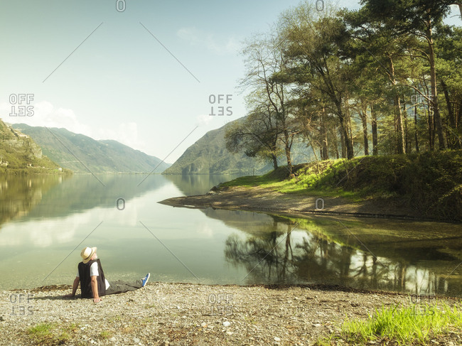 Italy- Lombardy- senior man having a break at Lake Idro