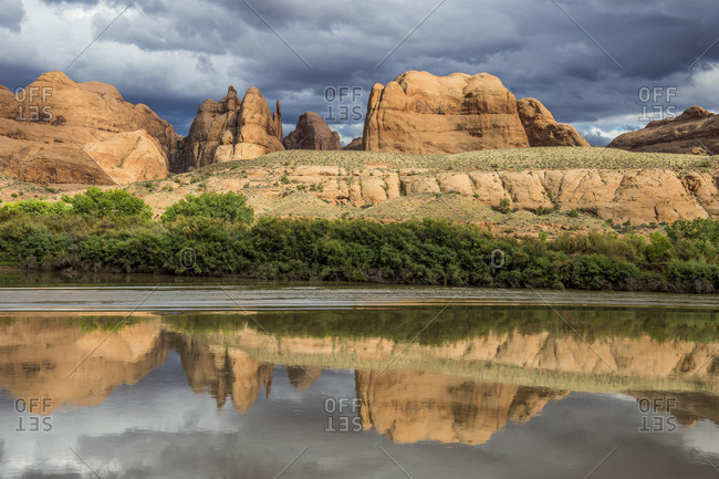 USA- Utah- Sandstone rocks reflecting in the Colorado river- Canyonlands National Park