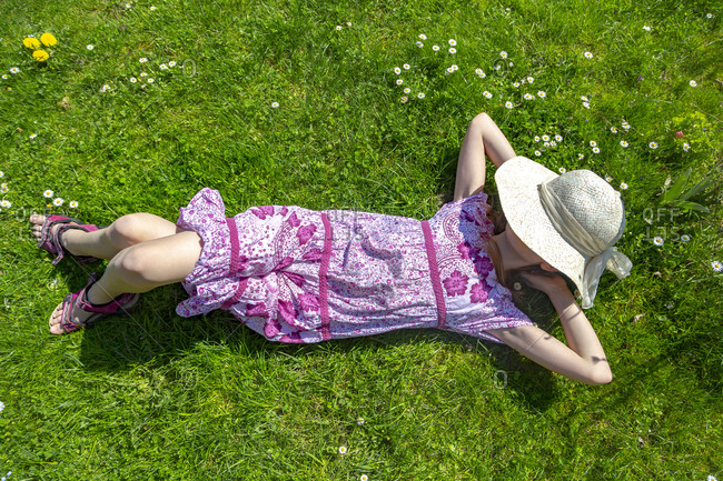 Girl lying on meadow in garden
