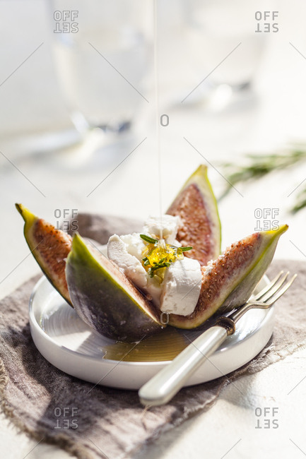 Figs and goat cheese- rosemary- pouring with honey