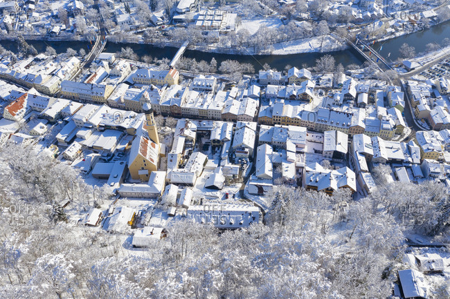 Germany- Bavaria- Wolfratshausen- view over old town and Loisach river in winter- aerial view