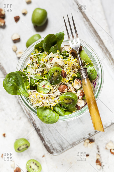 Quinoa salad with lamb's lettuce- cabbage- mini kiwi and hazelnuts