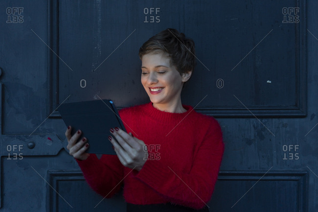Portrait of smiling businesswoman using digital tablet at twilight