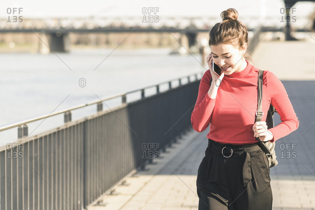 Young woman on the phone in the city