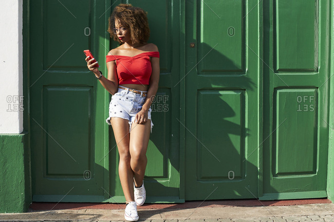 Woman in red checking her phone