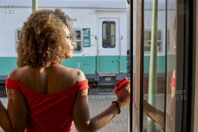 Woman looking out of train door