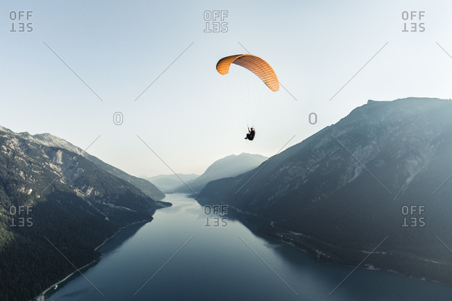 Austria- Tyrol- Paraglider over lake Achensee in the early morning