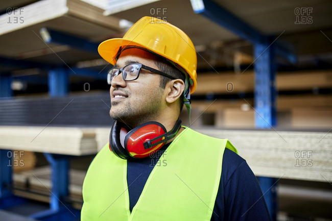 Portrait of smiling worker in factory warehouse
