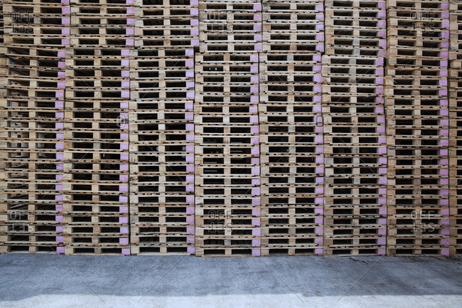 Stacks of pallets on factory yard