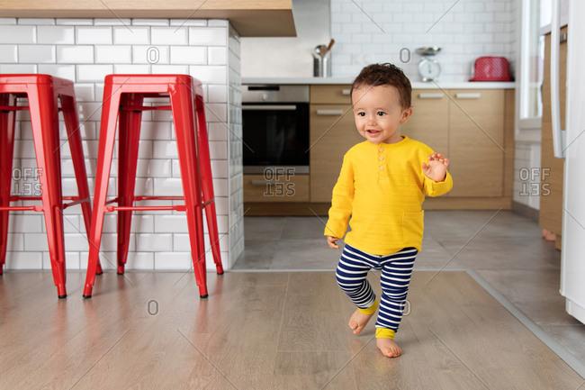 Toddler walking at home