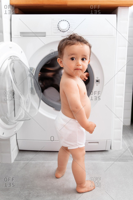 Toddler with washing machine
