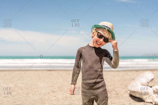 Happy blonde boy smiling on the beach