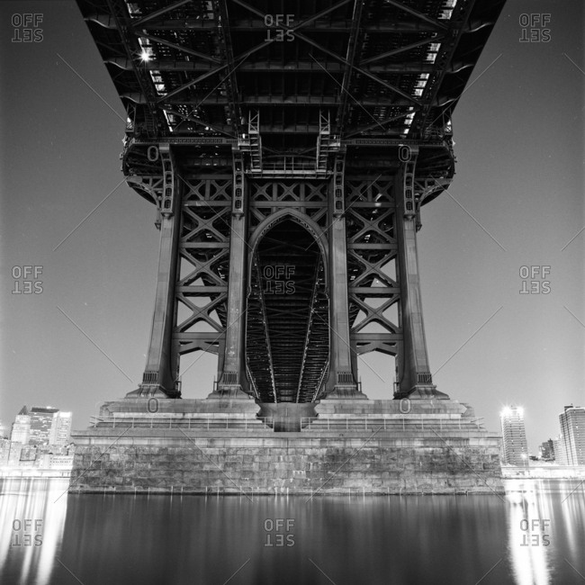 Low angle view of the Manhattan Bridge in black and white