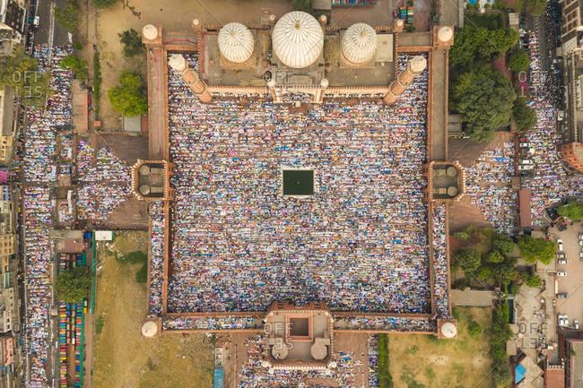 DELHI, INDIA - 5 JUNE 2019: Aerial view of devotees at prayer during Eid al-Fitr at Jama Masjid mosque.