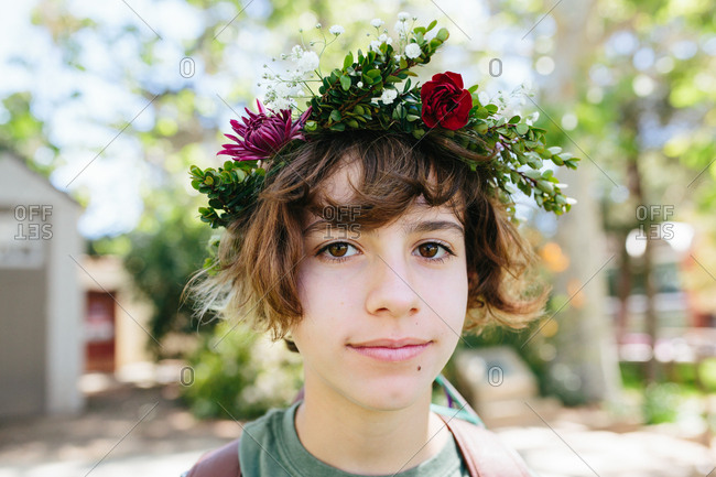 Close-up portrait of a young teen girl wearing a flower crown outside