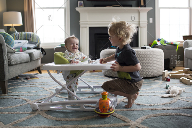 Baby Brother in Walker Laughs at Big Brother, in Their Living Room