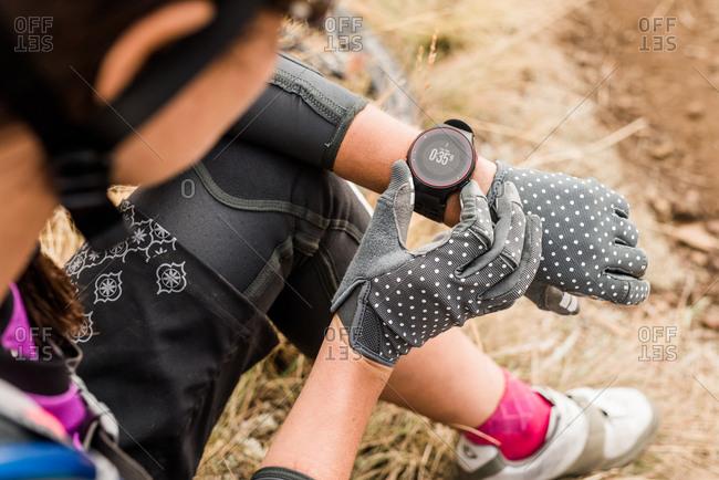 Female mountain biker checking her watch