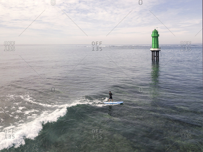 Aerial view of stand up paddle surfing