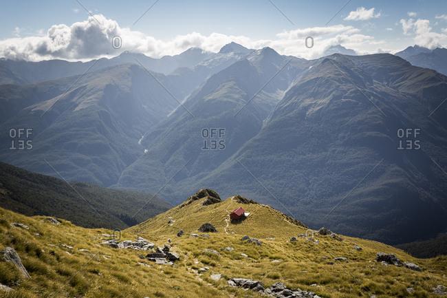 Remote wilderness hut in mountain scene in New Zealand