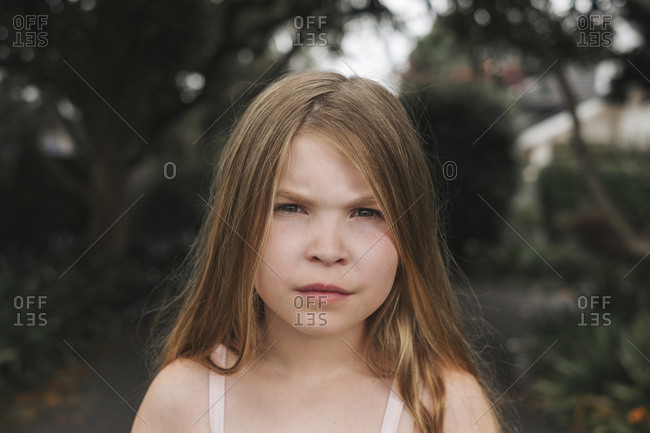 Young girl with a serious face looking forward