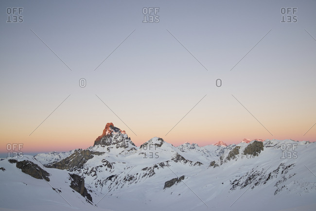 Snowy mountains in the Pyrenees, highlights the Midi D'ossau peak.