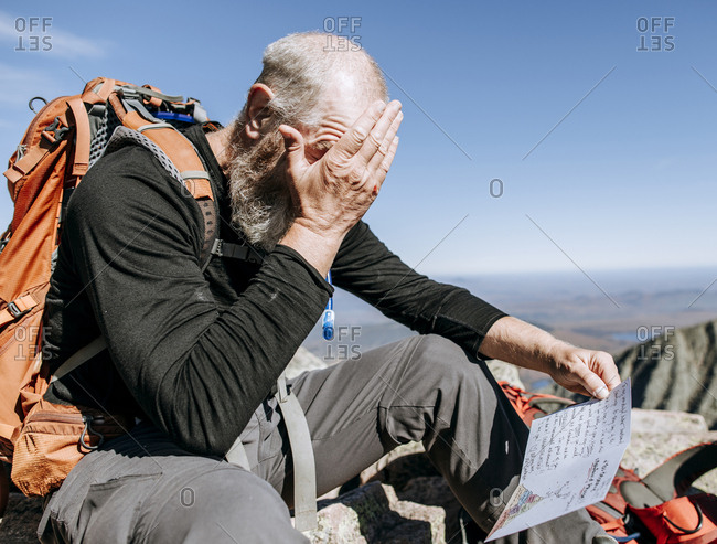 Hiker reads congratulations cards after walking the Appalachian Trail